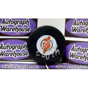 Travis Zajac Autographed Hockey Puck (New Jersey Devils