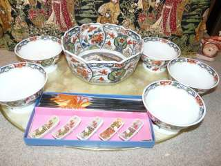 Lovely Asian Lotus Flower Dinnerware for Five includes chop stick