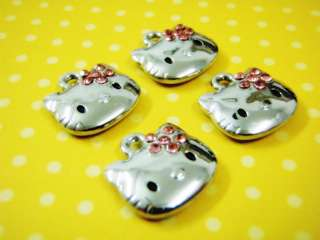 Bag filled with 4 CUTEST HELLO KITTY Charms Brand new