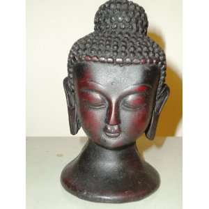 Lord Buddha Head in Meditation.A Buddhist god statue figure in Resin